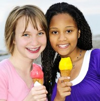 Portrait of two teenage girls eating ice cream cones
