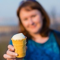 Girl with traditional Russian ice cream in waffle cup