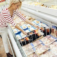 Beautiful woman shopping  and choosing food in supermarket